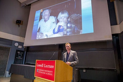 "During the Lowell Lecture, Philippe Cousteau asked the students in the audience to view whatever career they choose through the lens of sustainability. ""Please think about how we can leverage capital markets to change the world, and turn all of this money in a positive direction,"" he said. Cousteau is pictured with his grandfather, Jacques Cousteau."