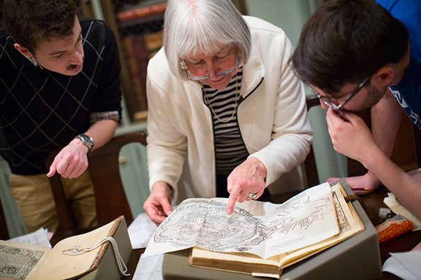 "On the 400th anniversary of Miguel de Cervantes' death, Professor Mary Gaylord brought two of her grad students,  José Ángel De León (left) and Rodrigo del Rio, to Houghton Library to see works related to Cervantes, the author of ""Don Quixote de la Mancha."""