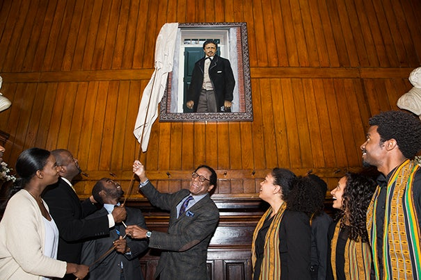 Harvard Foundation Director S. Allen Counter (center) presided over the unveiling of Richard Theodore Greener's portrait. Greener, Class of 1870, was the first African-American to graduate from Harvard College. He went on to teach philosophy, mathematics, languages, and history at the University of South Carolina.