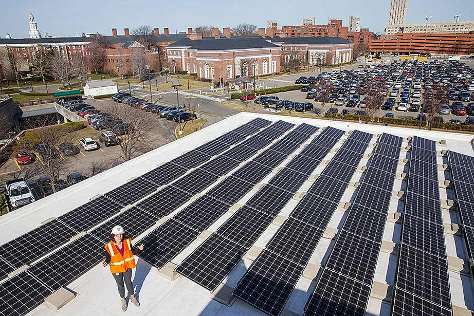 Standing on the roof of Batten Hall, Julia Musso, the energy and sustainability coordinator for Harvard Business School, shows an array of 113kW solar panels that provide energy for the HBS campus. The University has installed more than 1MW of solar panels on rooftops across its Cambridge and Boston campuses.