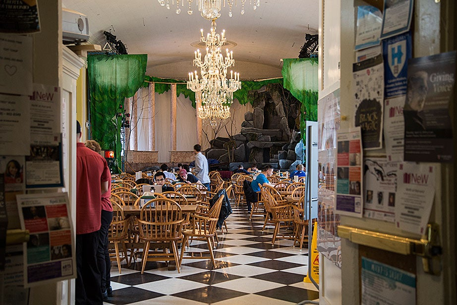 A morning inside the Lowell House dining hall, with the House opera set in the background.