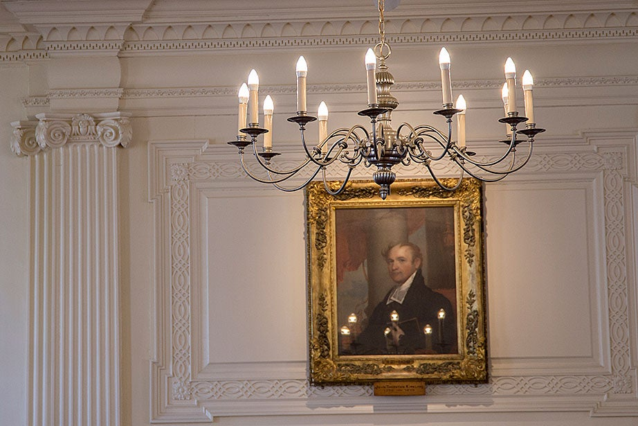A glimpse inside the Kirkland House dining hall reveals a portrait of John Thornton Kirkland, the 15th president of Harvard University.