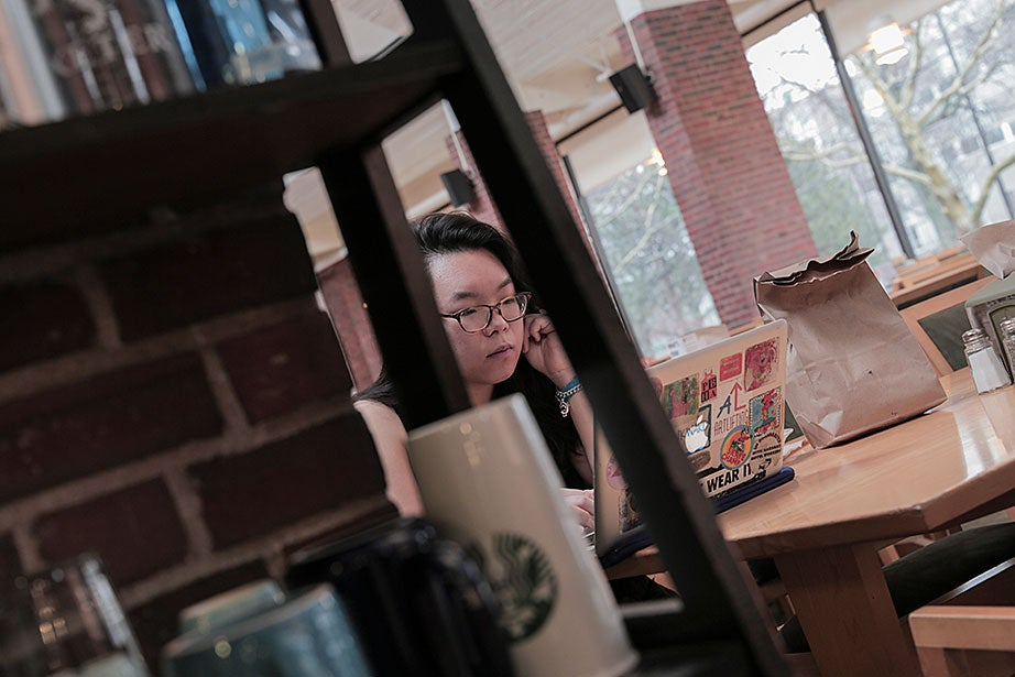 "Jing Qiu '16, who often studies in the Mather House dining hall, said, ""I love being here. You can see the sunset from the glass wall, and when it's the Regatta on the Charles, most of us just sit and watch it from here in our pajamas."""