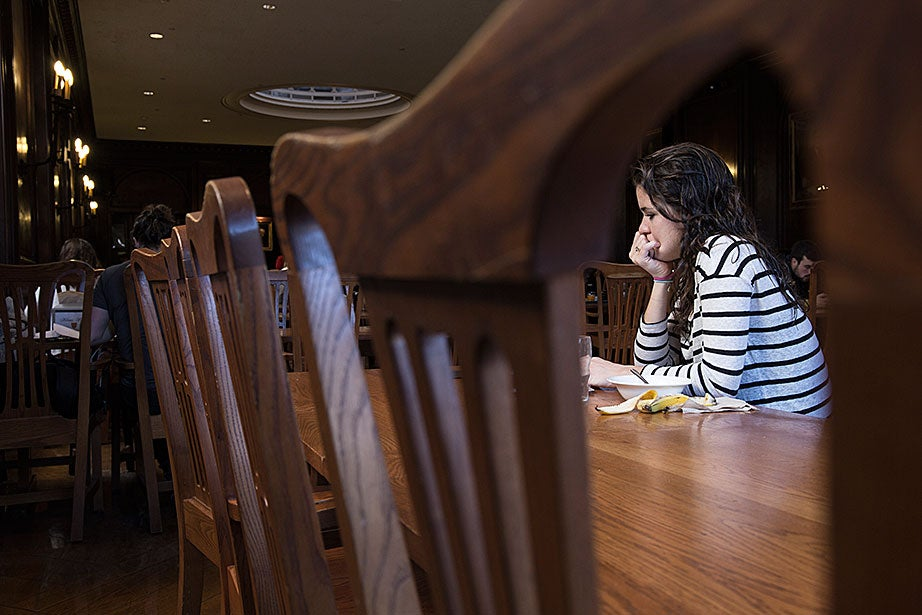 """Gabrielle Sejourne '18 can often be found studying in the Adams House dining hall. """"I like the fact that I can get my work done because it's not too loud in here, but it's not as suffocating as the library could be,"""" said Sejourne."""