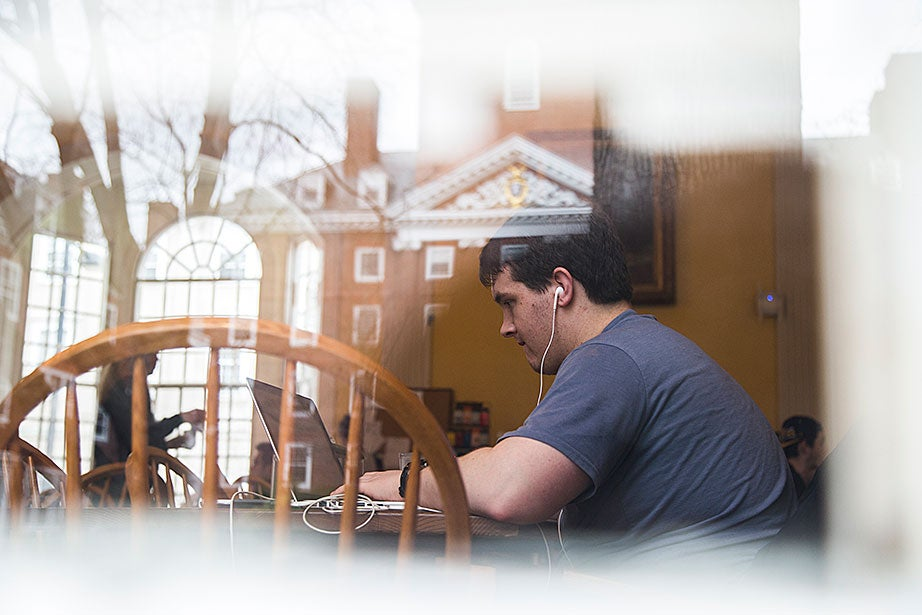 """Roman Berens '16 says he spends more time studying in the Lowell House dining hall than anyone else in the house. """"I have been here since 10 last night and it's time for breakfast now. I just love being here more than my room,"""" says Berens."""