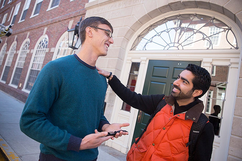 """Alex Hem '16, who works with the Undergraduate Resource Efficiency Program, talks with Jose """"Memo"""" Guillermo Cedeño Laurent, a researcher at the Harvard T.H. Chan School of Public Health, outside the newly renovated McKinlock Hall at Leverett House. Hem participated in a """"living laboratory"""" study led by Laurent, who won two Climate Change Solutions Fund grants at Harvard. This study monitors students' wellness, sleep, and fitness habits. """"We want to understand how buildings can enable our students not only to be the most accomplished, but also to be as healthy and happy as they can be,"""" says Laurent."""