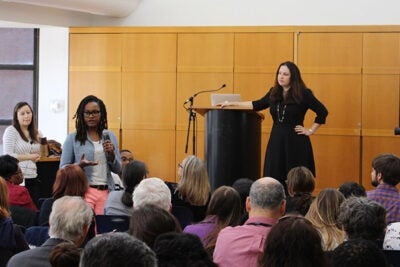 "Katherine Emerson (left), a research associate at Mills College, and Mary Murphy (right), assistant professor of psychology at Indiana University, listened as an audience member asked a question during the Diversity Dialogue ""Identity Threat at Work."" During the talk, Murphy cited studies that illustrate how social identity threat can negatively impact almost anyone."