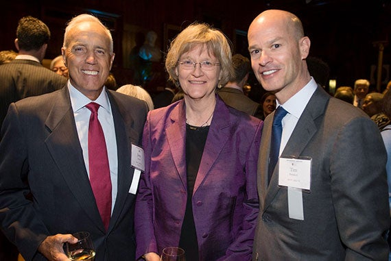 Jerry Jordan '61, M.B.A. '67 (left) and Tim Barakett '87, M.B.A. '93 (right), along with their wives, served as co-hosts of the dinner. Harvard President Drew Gilpin Faust (center) attended.