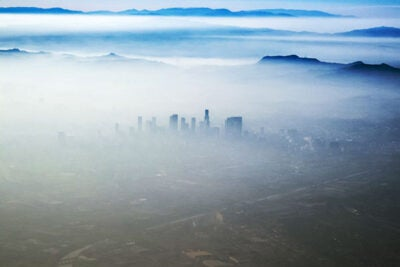 """High temperatures are also accompanied by weak winds, causing the atmosphere to stagnate. So the air just cooks and ozone levels can build up,"" said Loretta J. Mickley, a co-author of the study. Pictured is the smog that sometimes blankets Los Angeles."