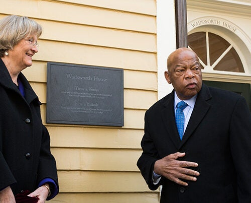 "Harvard President Drew Faust and Congressman John Lewis unveil a plaque memorializing four slaves who lived and worked in Wadsworth House during the 1700s. ""We name the names to remember those stolen lives,"" said Faust. Photo by Rose Lincoln/Harvard Staff Photographer"