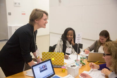 Kate Fleming (from left) of Boston Public Schools talks with Yeshi Lamour and Erin Vanderveer from Holmes Elementary School. HarvardX's Data Wise course is facilitating conversation among educators across the city.