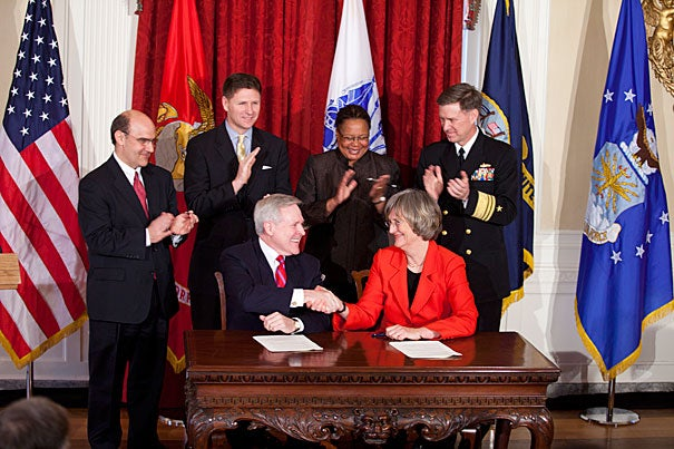 Navy Secretary Ray Mabus, J.D. '76 (left) and President Drew Faust sign the 2011 agreement to bring the ROTC program back to Harvard's campus. Rose Lincoln/Harvard Staff Photographer