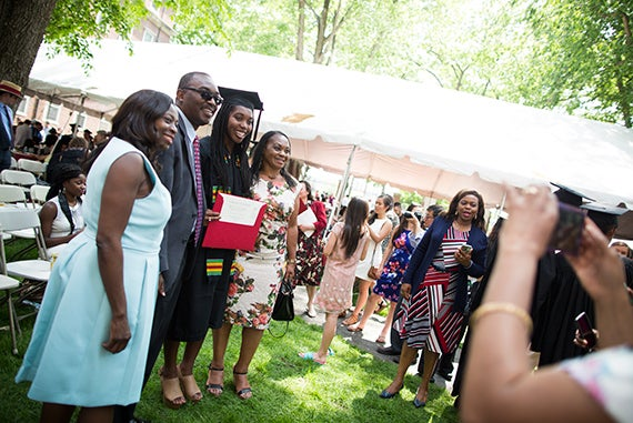 """It's the happiest day of my life,"" said Empress Elabor, whose only daughter, Ivie Tokunboh, graduated today. Commencement 2016. At the Winthrop House diploma presentation a family portrait was taken: Femi Tokunboh (from left), Kenny Tokunboh, Ivie Tokunboh, and Empress Elabor. Stephanie Mitchell/Harvard Staff Photographer"