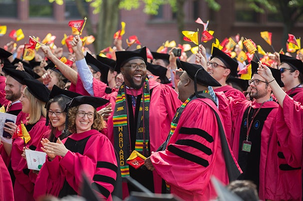 Mather House resident tutor Tony Jack, (center) celebrates with Ph.D. recipients celebrate during the 365th Commencement Exercises in the Tercentenary Theatre Kris Snibbe/Harvard Staff Photographer