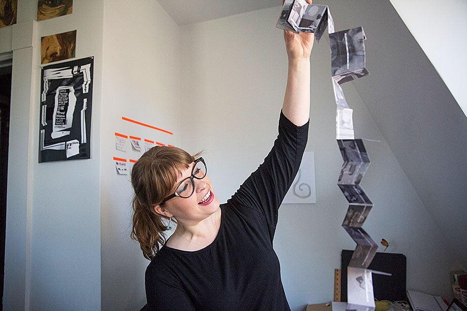 "Designer Marshall Lambert works on a bookmaking project inside the metaLAB. ""Designing with the people of metaLAB is something I consider quite rare and special,"" she says. ""In a certain light, we are this family of humble, curious, and creative misfits who get to come in every day and create, think, explore, and dream together. We're all filled with various skills that complement each other well in the making and execution of projects. In that way, metaLAB is a wondrous place."""