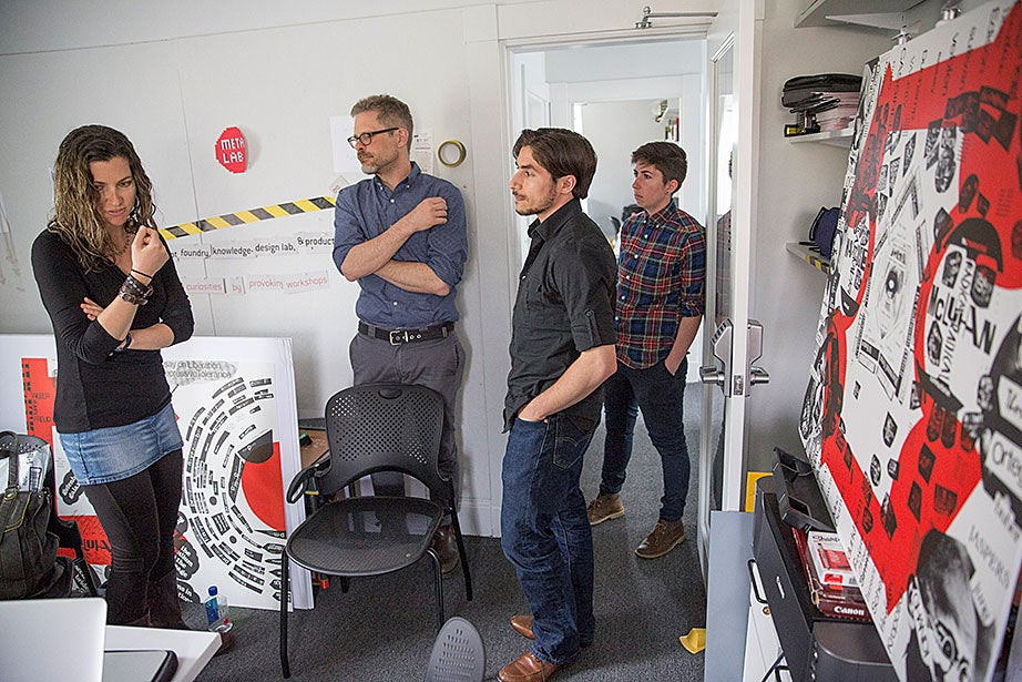 "Sarah Newman (from left), Matthew Battles, Cristoforo Magliozzi, and Jessica Yurkofsky discuss their work inside the metaLAB office/studios. ""With digital technology roiling education, publishing, and visual culture, the arts and humanities sometimes seem imperiled, even under assault. But Harvard's metaLAB doesn't see things that way,"" says Battles."