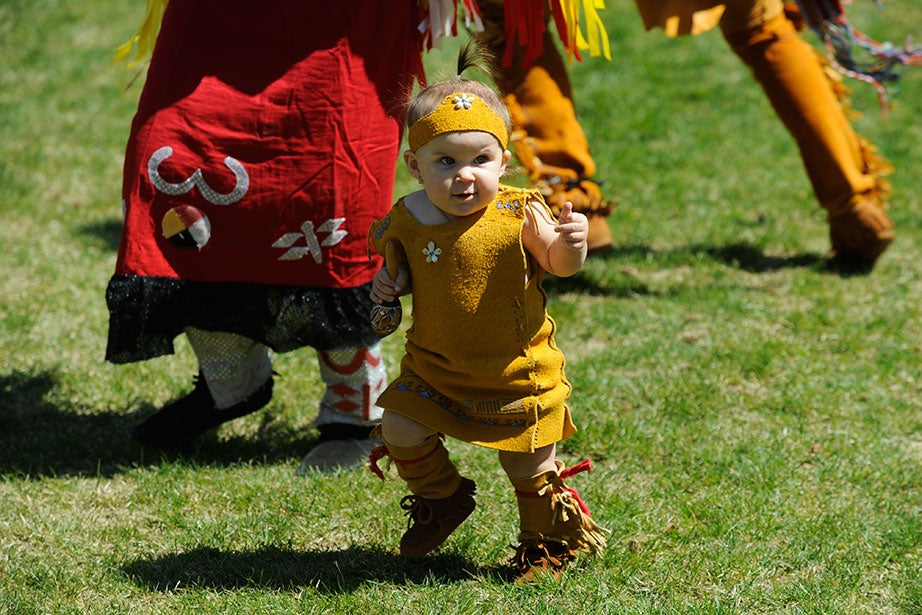 Braelin Lettner, 14 months, a Nipmuc from Palmer, Mass., joins in the dancing at the 21st annual Harvard Pow Wow in Radcliffe Yard. Seated in Grafton, Mass., the Nipmuc Nation claims more than 500 citizens.