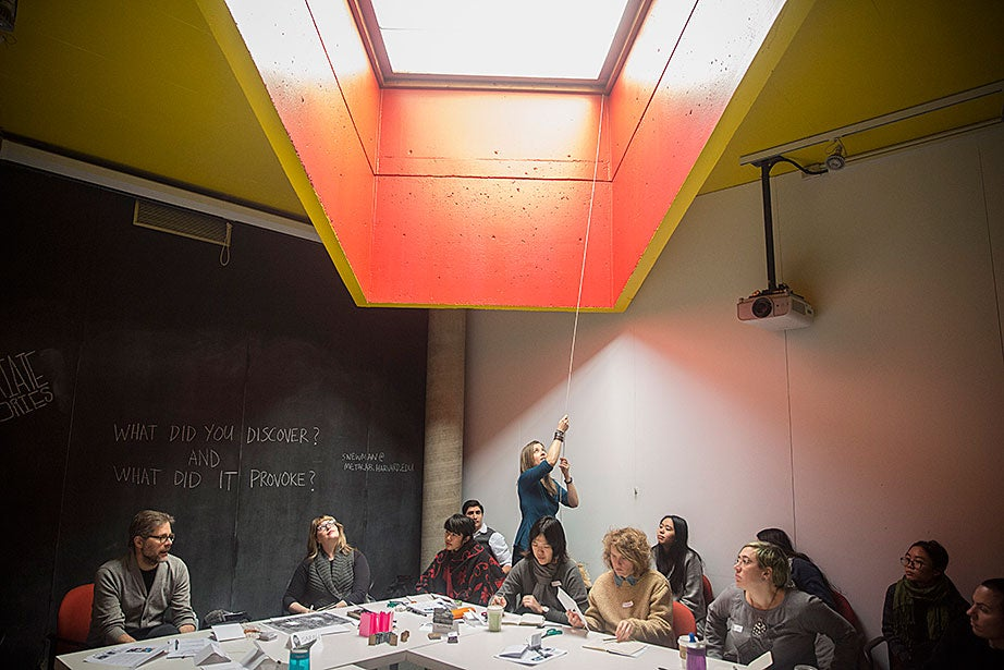"Matthew Battles (from left), Marshall Lambert, Sarah Newman, and Cristoforo Magliozzi teach a Wintersession studio-based design workshop. ""In its playful pursuit of interdisciplinary utopia, metaLAB can seem like an island of broken toys: peopled by architects who want to build software; artists interested in technology's impact on meaning and memory; and designers who are curious about drones, data visualization, or the history of the book,"" says Battles."