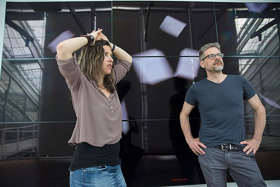 "Sarah Newman (left) and Matthew Battles, associate director of metaLAB at Harvard and a fellow at the Berkman Center for Internet & Society, work on ""Your Story Has Touched My Heart,"" a video installation exploring the Harvard Art Museums' American Professional Photographers Collection, acquired by sociologist and pioneering photo historian Barbara Norfleet."