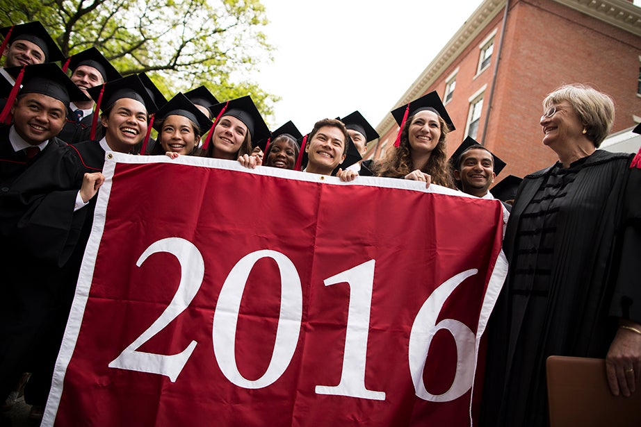 Seniors joined by President Drew Faust (right) gather to process to their Baccalaureate Service in Memorial Church. Stephanie Mitchell/Harvard Staff Photographer