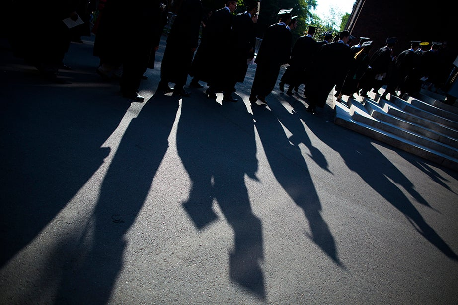 Seniors process into Memorial Church for the senior service. Stephanie Mitchell/Harvard Staff Photographer