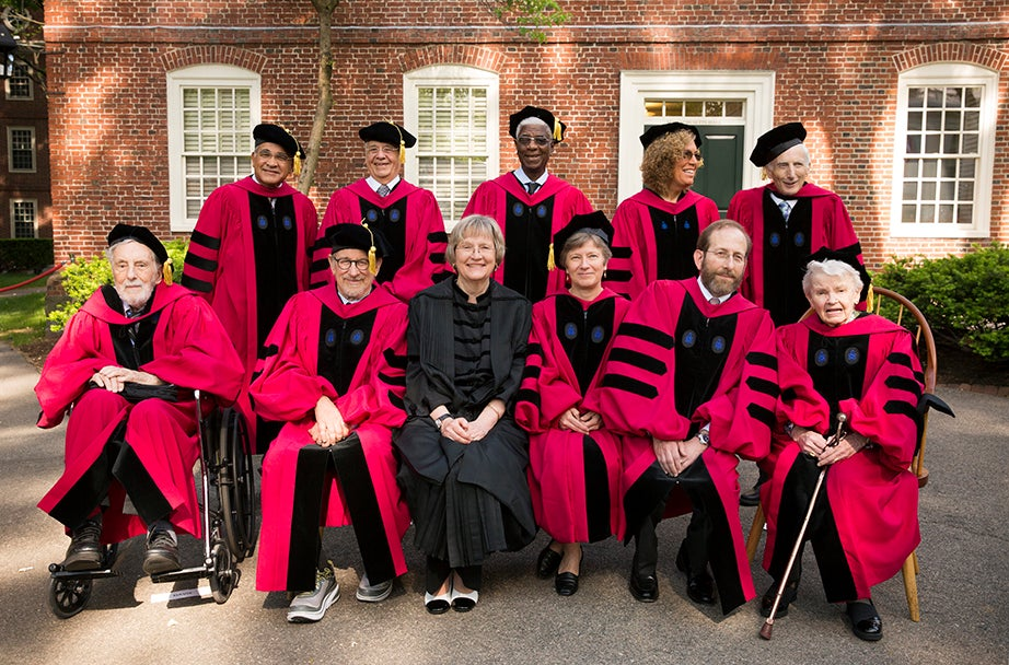 The honorary degree recipients pose for the annual group photo outside Massachusetts Hall. Stephanie Mitchell/Harvard Staff Photographer