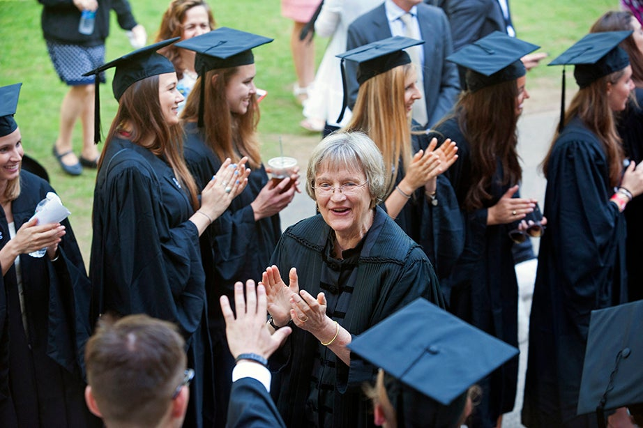 President Drew Faust greets graduates in the procession line. Jon Chase/Harvard Staff Photographer