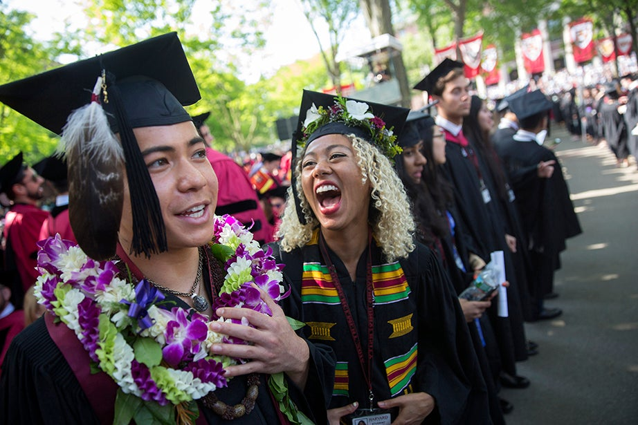 Ikaika Ramones '16 (left) and Kimiko Matsuda Lawrence '16 await the procession into Tercentenary Theatre. Kris Snibbe/Harvard Staff Photographer