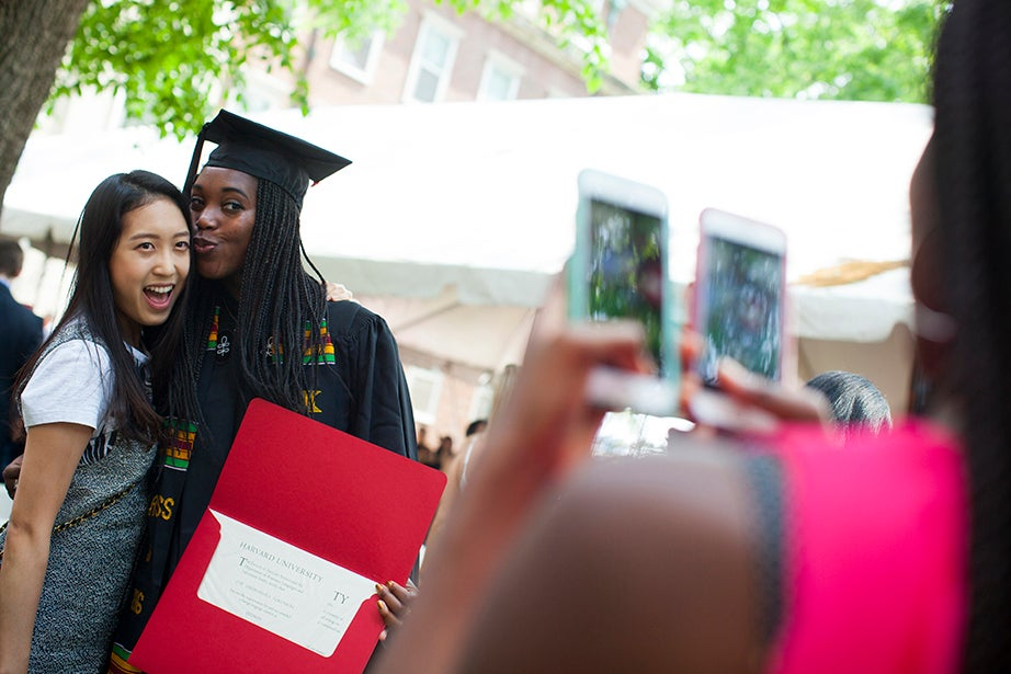 Ivie Tokunboh (right) is photographed with Eunice Kim after receiving her degree at the diploma presentation and luncheon at Winthrop House. Stephanie Mitchell/Harvard Staff Photographer