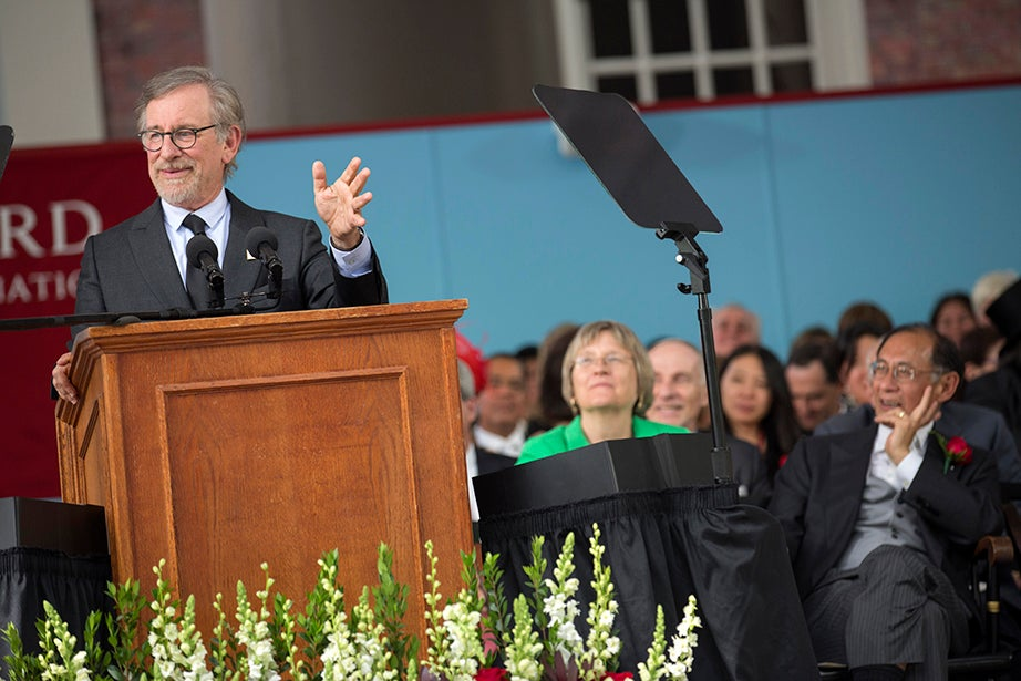 Commencement speaker Steven Spielberg (from left) gives his oration during the Annual Meeting of the Harvard Alumni Association (HAA) in Tercentenary Theatre. Harvard President Drew Faust and Bill Lee look on. Kris Snibbe/Harvard Staff Photographer
