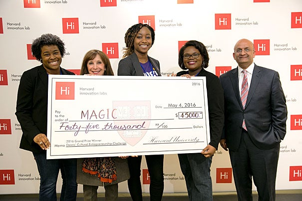 The winners of the fourth annual Deans' Challenges were announced recently. Arts and Humanities Dean Diana Sorensen (second from left) and Harvard Business School Dean Nitin Nohria (far right) stand with Deans' Cultural Challenge winners Shay Johnson (from left), Jenae Moxie, and Ke'Andra Levingston.