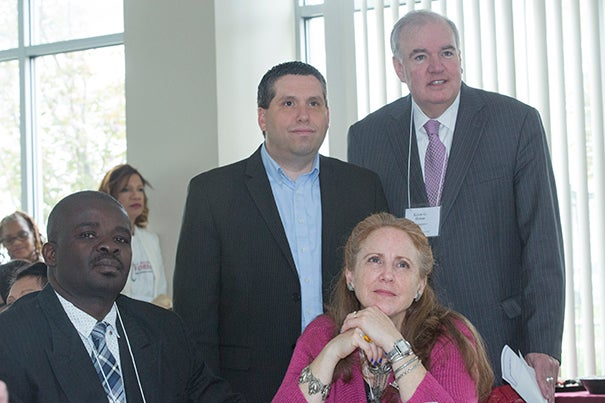 The Legislators' Breakfast brought together Wils Magloire (seated left) and Ann Pellagrini, both of the Jackson Mann Community Center, State Sen. Sal DiDomenico (standing left), and State Rep. Kevin G. Honan.