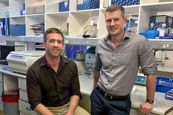 Harvard has granted a license to Aldatu Biosciences, a Cambridge-based startup, for a genotyping platform to address drug resistance in HIV patients. David Raiser (left), Ph.D.'15, and Iain MacLeod, a researcher at the Harvard Chan School, co-founded Aldatu in 2014.