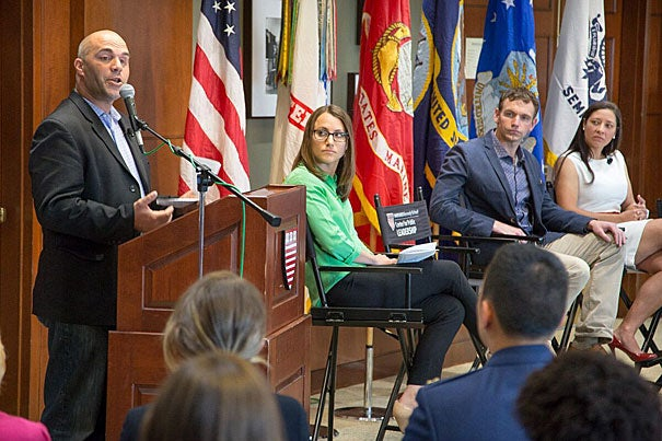 "As part of Veterans Impact Day, U.S. Army Major Dennis ""DJ"" Skelton (from left), moderator Katie Burkhart, Iraq War veteran Josh Mantz, and former Marine Kristen Kavanaugh participated in a panel discussion."