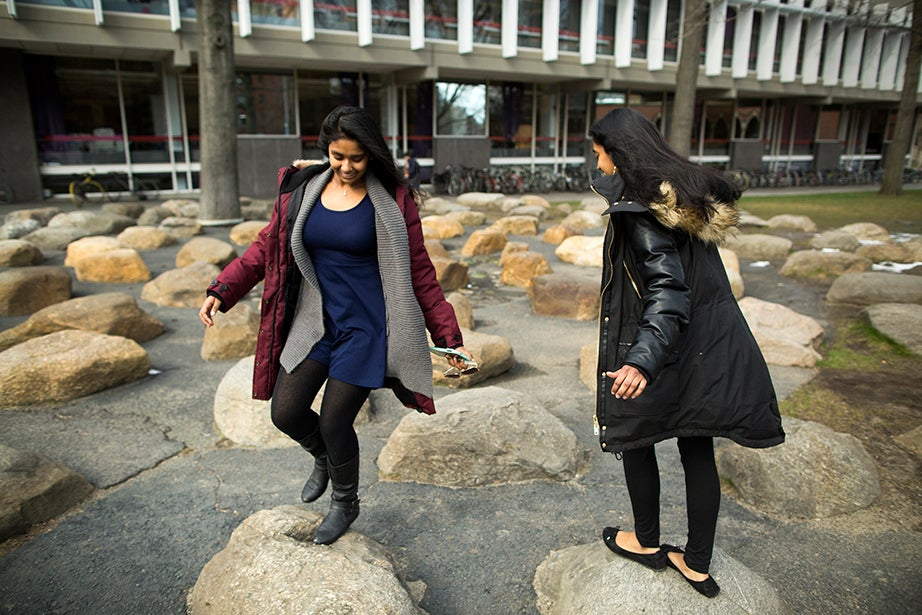 """""""When you're together and you're twins, a lot of people perceive you to be the same person,"""" says Anne Raheem. """"Our parents encouraged us to be our own unique individuals."""" Stephanie Mitchell/Harvard Staff Photographer"""