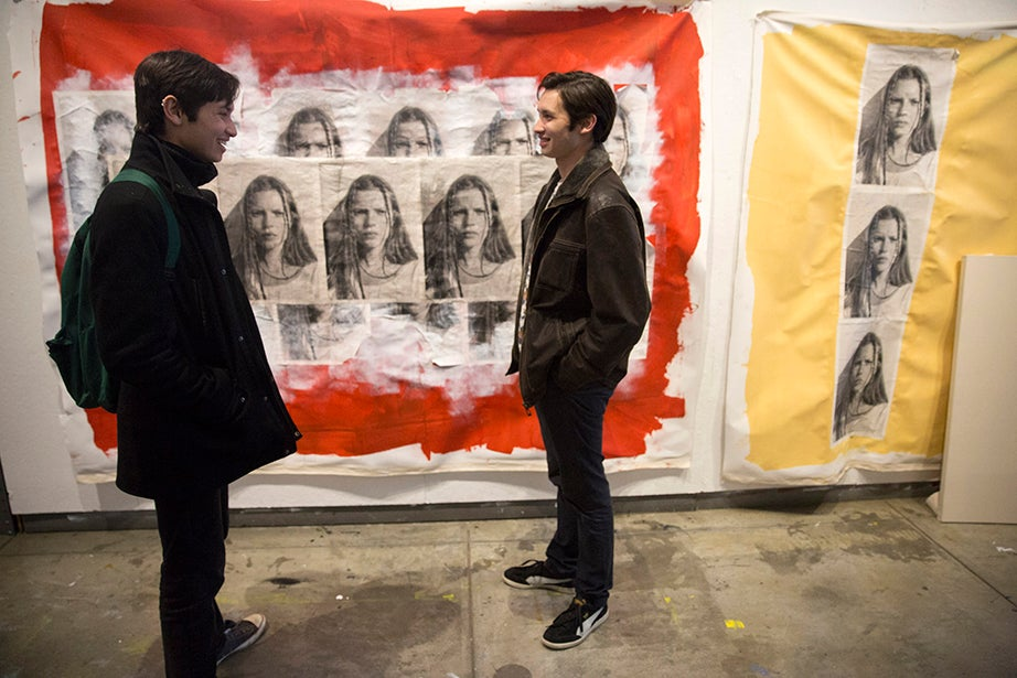 Eli (left) and Alex Lee '17 admire a giant mixed-media work by classmate My Ngoc To '16 in the Carpenter Center. Alex has studied drawing and film as part of his undergraduate concentration. Kris Snibbe/Harvard Staff Photographer