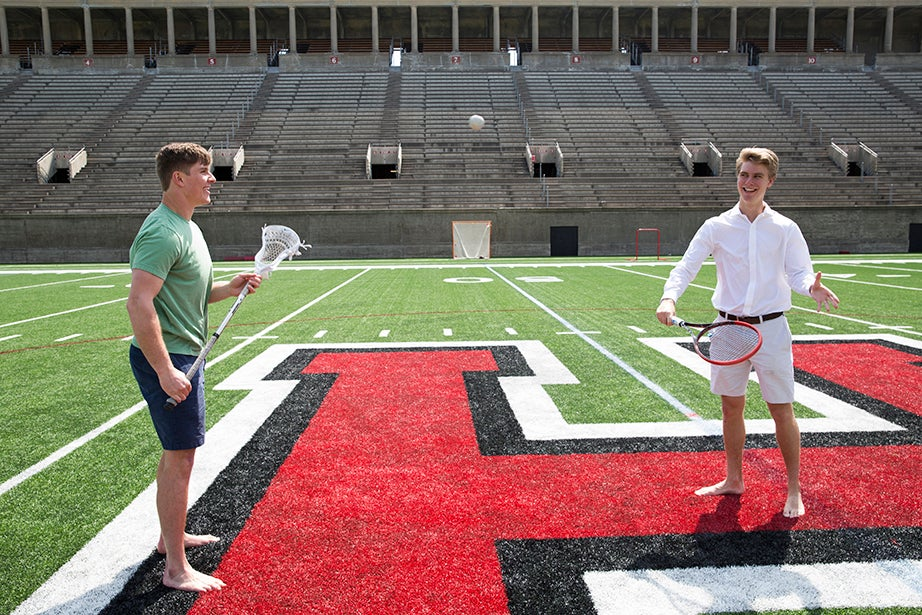 Harvard sophomores Beau (left) and Nicholas Bayh toss a ball on the turf at Harvard Stadium. Jon Chase/Harvard Staff Photographer