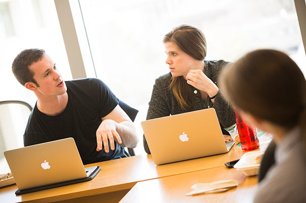 Harvard Law School (HLS) students Josh Looney '18 (left) and Chloe Goodwin '18 (center) are part of a group of 26 students working with HLS legal fellow Anna Kastner (right) on the Clemency Project, which aims to gain clemency for felons serving time.