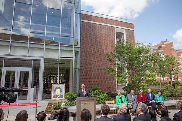 Harvard Business School Dean Nitin Nohria (at podium) speaks at the opening of the Ruth Mulan Chu Chao Center.