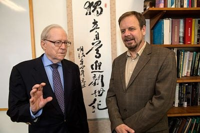 University Professor Dale Jorgenson from the Harvard Kennedy School (left) and China Project Executive Director Chris Nielsen speak about the possibility of China enacting a carbon tax to fight climate change.
