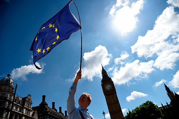 James Laurent waved a European Union flag outside the houses of Parliament in London on Friday.