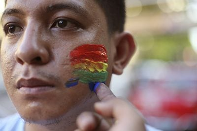 The shooting was mourned around the world, including in the Philippines, where a youth activist had his face painted to honor the victims.