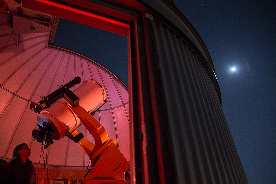 Lab manager Allyson Bieryla observes the night sky through the Clay Telescope on the roof of the Science Center. The Harvard Observatory Project (HOP) uses the telescope to get undergraduate students interested in astronomy and give graduate students a chance to interact with undergrads.
