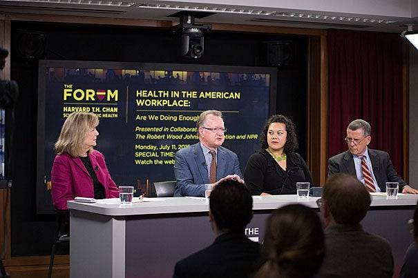 Glorian Sorensen (from left), John Quelch, Marjorie Paloma, and Robert Blendon discussed the sobering findings of a Harvard Chan School survey on workplace health and what businesses can do to improve their employees' well-being.