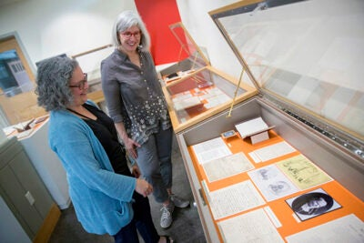 Jennifer Weintraub (left), digital archivist/librarian, and Jane Kamensky, Schlesinger Library director, view a selection of items from the Blackwell collection before they are installed in the new exhibit.