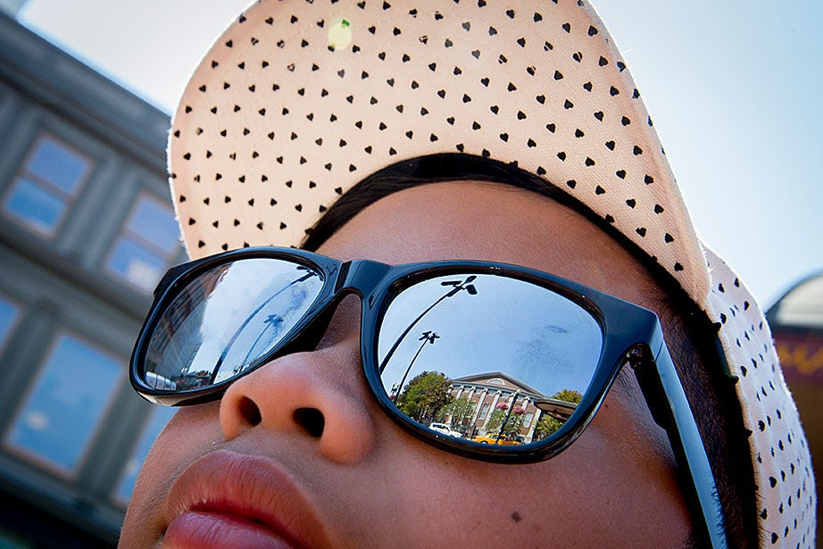 """Enrico Benitez, 13, of California, waited in Harvard Square for his campus tour. What did he think the campus would be like? """"I'm expecting it to be grand and marble,"""" Benitez said."""