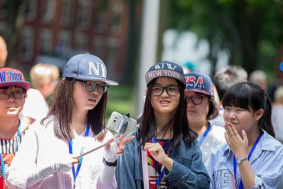 These Chinese tourists bought lots of swag in New York City on their way to Boston.