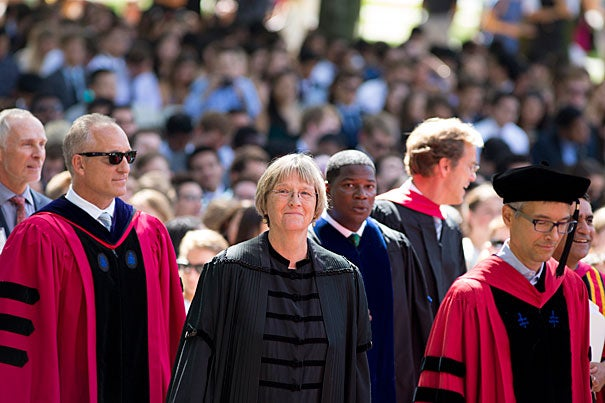 The class of 2020 kicked off their their time at Harvard in Tercentenary Theatre for Convocation and an official welcome from Drew Faust, center, president of Harvard University. Dean of Faculty Mike Smith is on left.