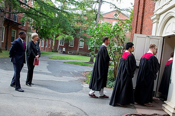 Jonathan Walton, Plummer Professor of Christian Morals, (left) and President Drew Faust follow the procession into Holden Chapel. Rose Lincoln/Harvard Staff Photographer