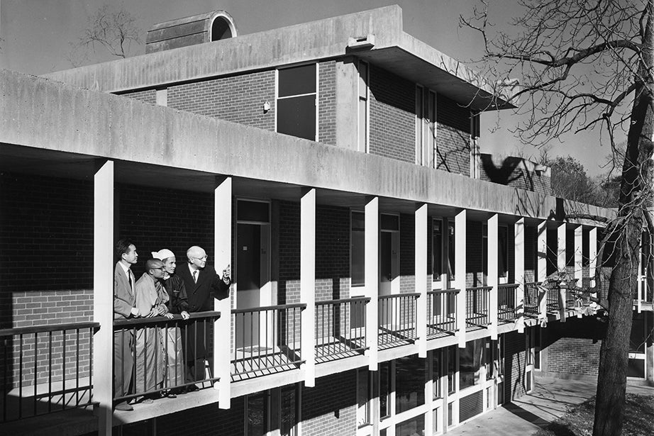 First CSWR director Robert Slater (right) exploring the new building in 1960 with three of its first affiliates: Sao Htun Hmat Win (from left), a Buddhist scholar from Burma; Rabindrabijay Sraman, a Buddhist monk from Pakistan; and Nobusada Nishitakatsuji, a Shinto priest from Japan. Photo courtesy of Andover-Harvard Theological Library